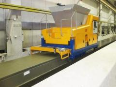 Machine for the production of hollow core slabs by extrusion