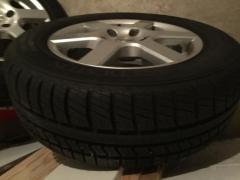 Автомобильные шины М + S новые. Пробег 70 км. Автомобильные алюминиевые диски 4 шт. Б/У.